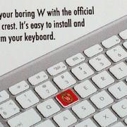 Keyboard sticker shows love for school